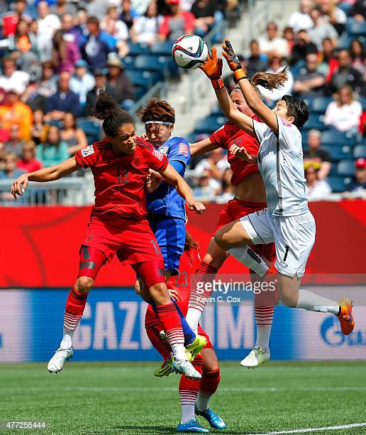 Goalkeeper Waraporn Boonsing of Thailand saves a shot on goal against Celia Sasic and Melanie Leupolz of Germany during the FIFA Women's World Cup...
