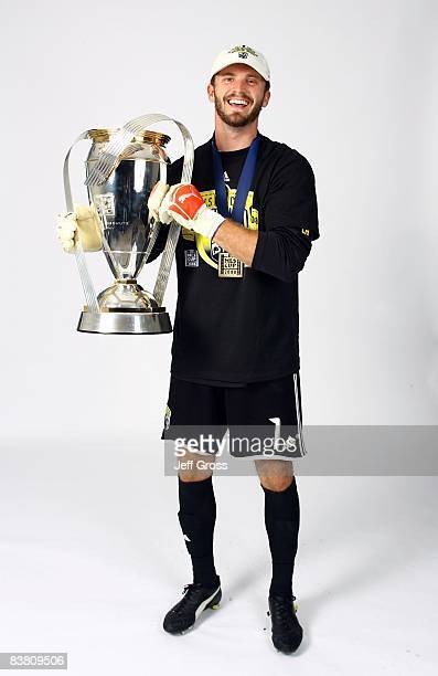 Goalkeeper Will Hesmer of the Columbus Crew poses for a postgame celebration portrait with the Philip F Anschutz trophy after defeating the New York...