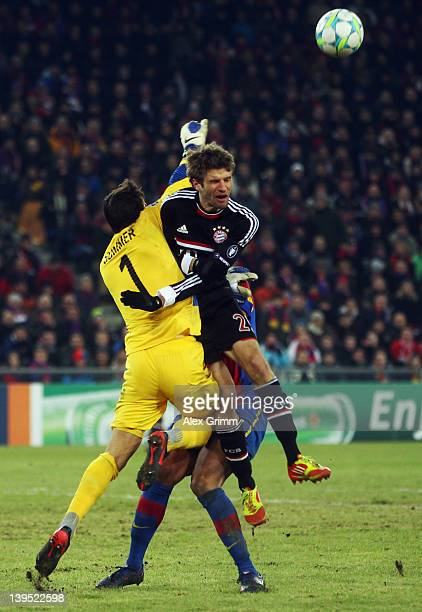 Goalkeeper Yann Sommer of Basel is challenged by Thomas Mueller of Muenchen during the UEFA Champions League Round of 16 first leg match between FC...