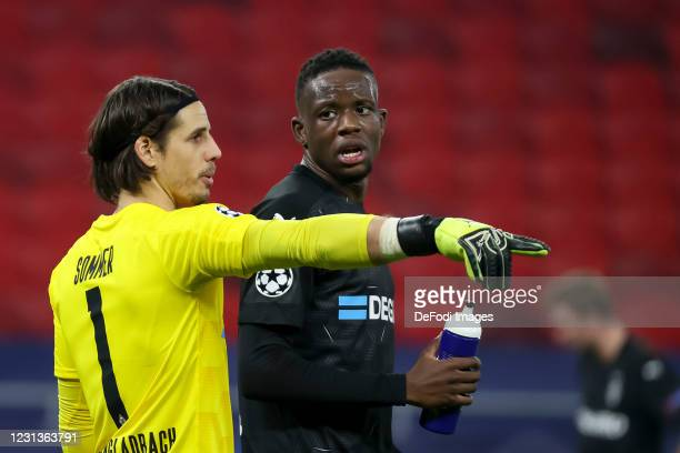 Goalkeeper Yann Sommer of Borussia Moenchengladbach and Denis Zakaria of Borussia Moenchengladbach looks on during the UEFA Champions League Round of...