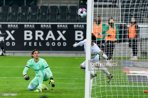 Goalkeeper Yann Sommer of Borussia Moenchengladbach and Lars Stindl of Borussia Moenchengladbach controls the ball during the Bundesliga match...