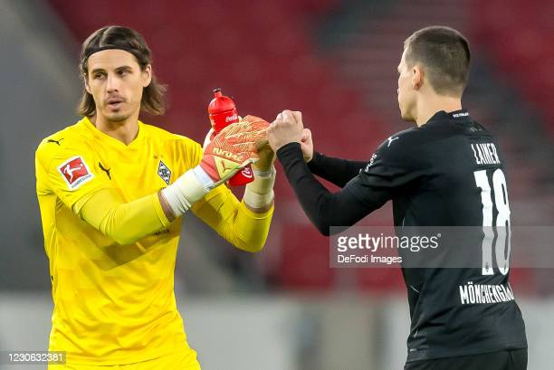 Goalkeeper Yann Sommer of Borussia Moenchengladbach and Stefan Lainer of Borussia Moenchengladbach gestures during the Bundesliga match between VfB...