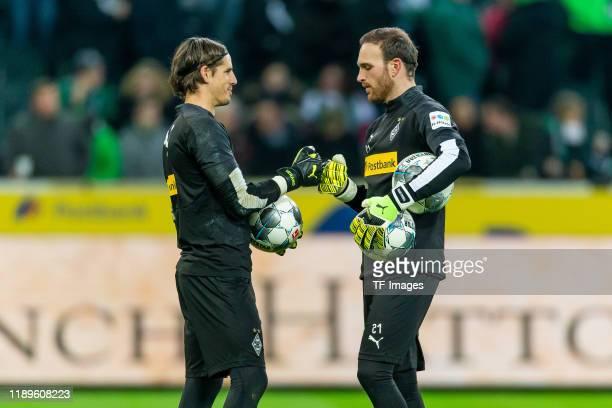 Goalkeeper Yann Sommer of Borussia Monechengladbach and Tobias Sippel of Borussia Monechengladbach gestures during the Bundesliga match between...