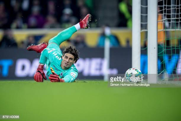 Goalkeeper Yann Sommer of Moenchengladbach dives in vain as Arturo Vidal of Muenchen scores his side's first goal during the Bundesliga match between...