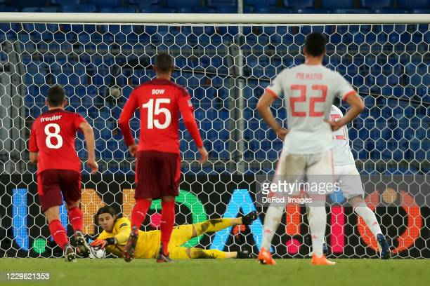 goalkeeper Yann Sommer of Switzerland and Sergio Ramos of Spain battle for the ball during the UEFA Nations League group stage match between...