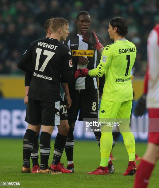 Goalkeeper Yann Sommer speaks with Oscar Wendt of Moenchengladbach and Denis Zakaria of Moenchengladbach during the Bundesliga match between Borussia...