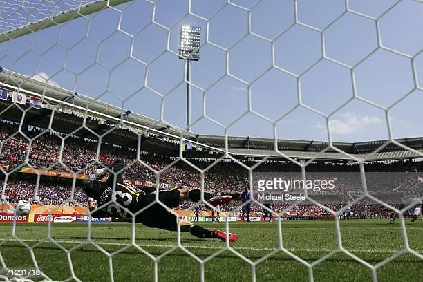 Goalkeeper Yoshikatsu Kawaguchi of Japan dives to save the penalty kick from Darijo Srna of Croatia during the FIFA World Cup Germany 2006 Group F...