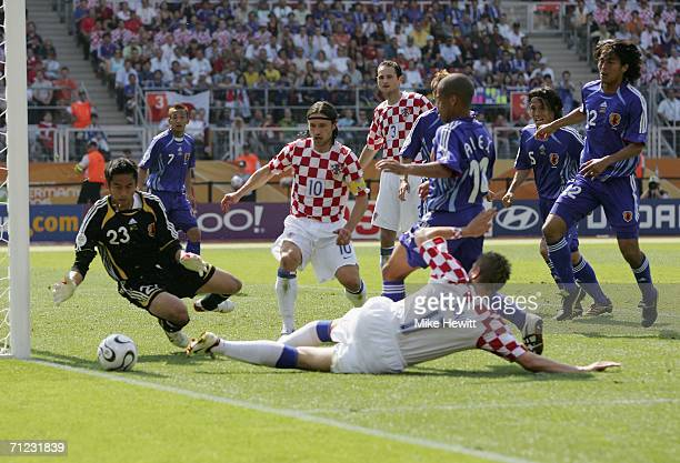 Goalkeeper Yoshikatsu Kawaguchi of Japan saves the attempt on goal by Ivan Klasnic of Croatia during the FIFA World Cup Germany 2006 Group F match...