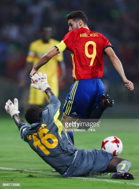 Goalkeeper Youssouf Koitaof Mali battles for the ball with Abel Ruiz of Spain during the FIFA U17 World Cup India 2017 Semi Final match between Mali...