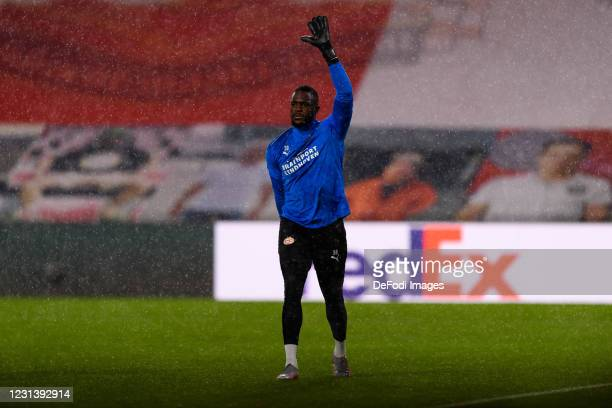 Goalkeeper Yvon Mvogo of PSV Eindhoven warm up during the UEFA Europa League Round of 32 match between PSV Eindhoven and Olympiakos Piraeus at on...