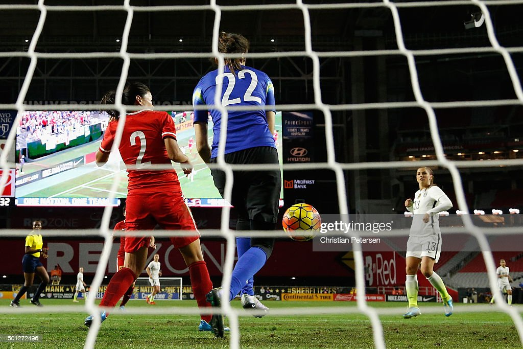 Goalkeeper Zhao Lina #22 of China makes a save on a shot from Alex Morgan #13 of the United States during the second half of the women's soccer match at University of Phoenix Stadium on December 13, 2015 in Glendale, Arizona. USA defeated China 2-0.