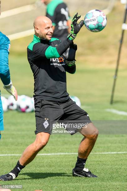 Goalkeeper-head coach Steffen Krebs of Borussia Moenchengladbach controls the ball during the first training session after the summer break on August...