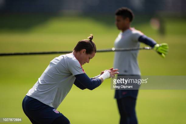Goalkeepers Ashlyn Harris and Adrianna Franch warm up for the US Women's National Team practice ahead of their friendly match against Chile at...