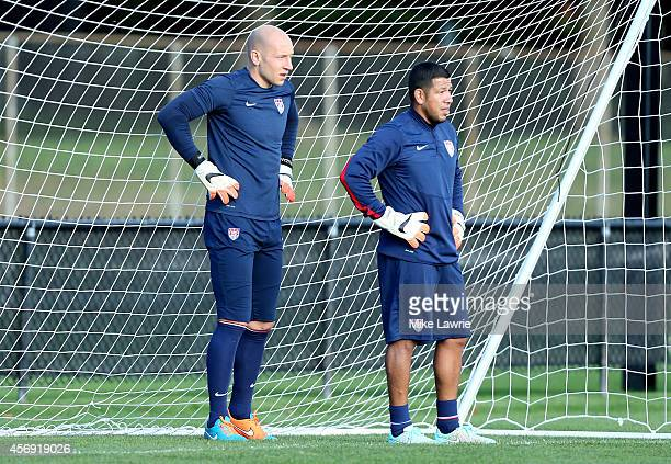 Goalkeepers Brad Guzan and Nick Rimando train during a United States soccer training session at Ohiri Field on October 8 2014 in Boston Massachusetts