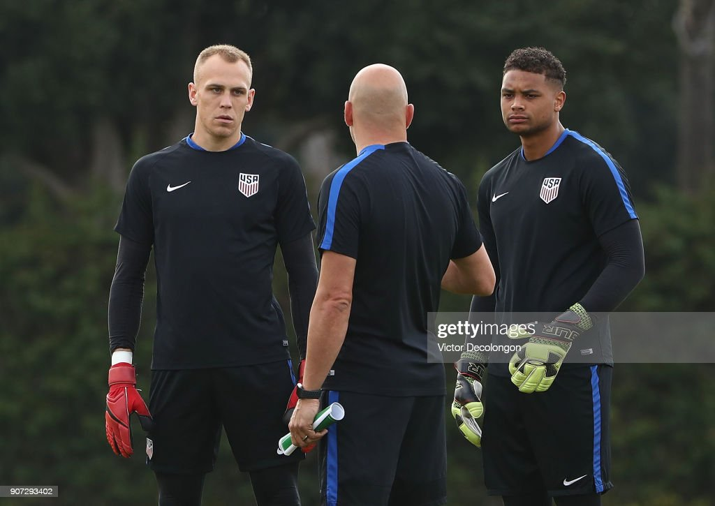 Goalkeepers Cody Cropper (L) and Zack Steffen (R) of the U.S. Men's National Soccer Team listen to instructions from goalkeeper coach Matt Reis during training at StubHub Center on January 19, 2018 in Carson, California.