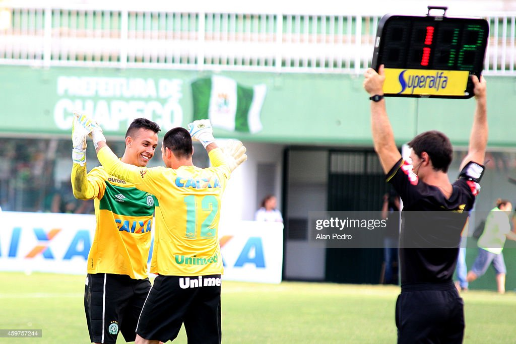 Goalkeepers #1 Danilo (L) and Nivaldo #12 of Chapecoense celbrate during a match between Chapecoense and Cruzeiro for the Brazilian Series A 2014 at Arena Conda Stadium on November 30, 2014 in Chapeco, Brazil.