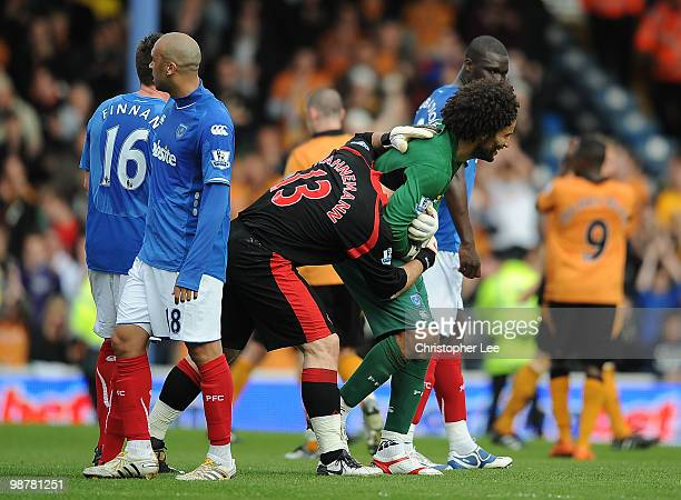 Goalkeeper's David James of Portsmouth and Marcus Hahnemann of Wolves joke around at the end of the match during the Barclays Premier League match...