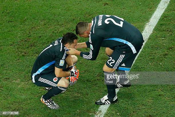 Goalkeepers David Ospina and Faryd Mondragon of Colombia react after being defeated by Brazil 21 during the 2014 FIFA World Cup Brazil Quarter Final...