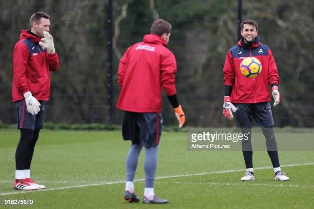 Goalkeepers Erwin Mulder Kristoffer Nordfeldt and Lukasz Fabianski warm up during the Swansea City Training and Press Conference at The Fairwood...