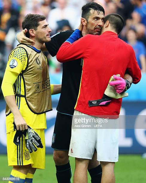 Goalkeepers Gianluigi Buffon of Italy consoles Iker Casillas and Alvaro Morata of Spain after the UEFA EURO 2016 round of 16 match between Italy and...