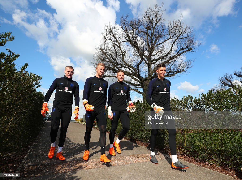 Goalkeepers Jordan Pickford, Joe Hart, Jack Butland and Nick Pope look on during an England training session, on the eve of their international friendly against Italy at Tottenham Hotspur Training Centre, on March 26, 2018 in Enfield, England.