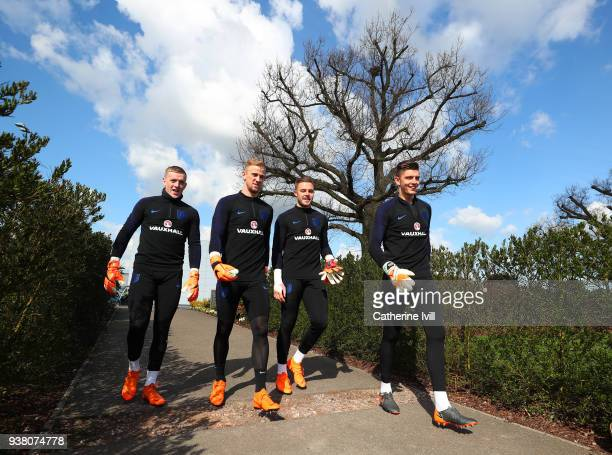 Goalkeepers Jordan Pickford Joe Hart Jack Butland and Nick Pope look on during an England training session on the eve of their international friendly...