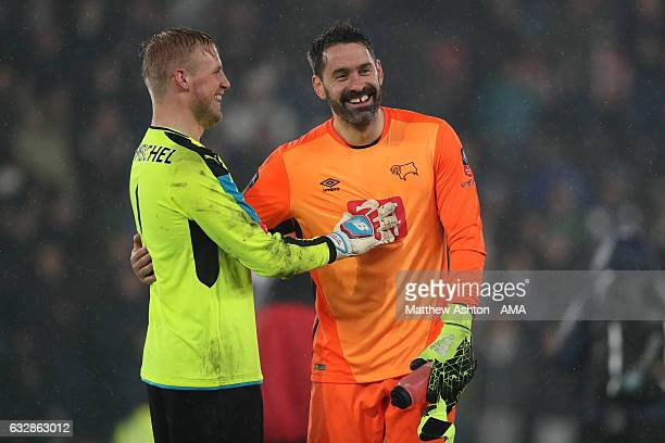 Goalkeepers Kasper Schmeichel of Leicester City and Scott Carson of Derby County during the Emirates FA Cup Fourth Round match between Derby County...