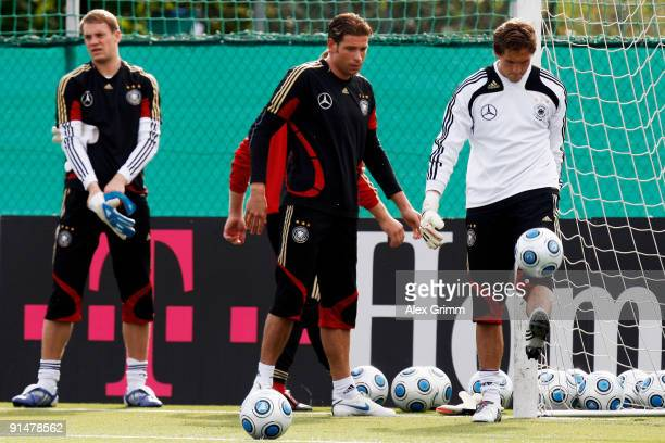 Goalkeepers Manuel Neuer Tim Wiese and Rene Adler prepare for a training session of the German national football team at the Bruchweg stadium...