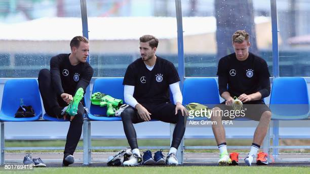 Goalkeepers MarcAndre ter Stegen Kevin Trapp and Bernd Leno prepare for a Germany training session at Sotchi Parc Arena ahead of their FIFA...