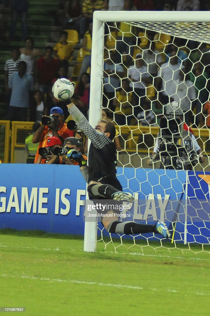 Goalkeepers Mika blocks a penalty kick in the penalty shoot out of the match between Argentina and Portugal as part of the U20 World Cup Colombia 2011 at Jaime Moron Stadium on August 13, 2011 in Cartagena, Colombia.