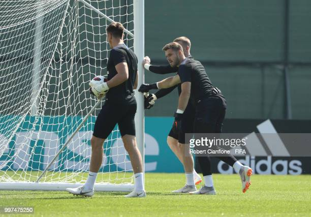 Goalkeepers Nick Pope Jack Butland and Jordan Pickford of England look on during an England training session during the 2018 FIFA World Cup Russia at...
