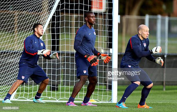 Goalkeepers Nick Rimando Bill Hamid and Brad Guzan train during a United States soccer training session at Ohiri Field on October 8 2014 in Boston...