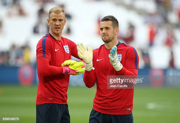 Goalkeepers of England Joe Hart and Tom Heaton warm up before the UEFA Euro 2016 Group B match between England and Russia at Stade Velodrome on June...