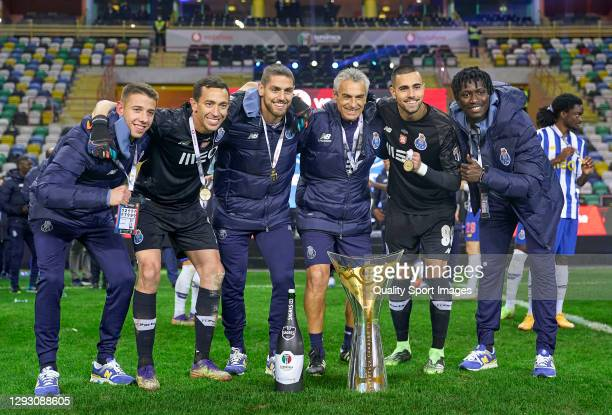 Goalkeepers of FC Porto pose with Candido de Oliveira trophy following his sides victory during the Portuguese Super Cup match between FC Porto and...