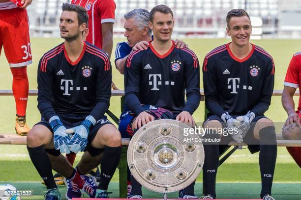 Goalkeepers of German first division Bundesliga football club FC Bayern Munich pose with the German league trophy on August 8 2017 in Munich southern...