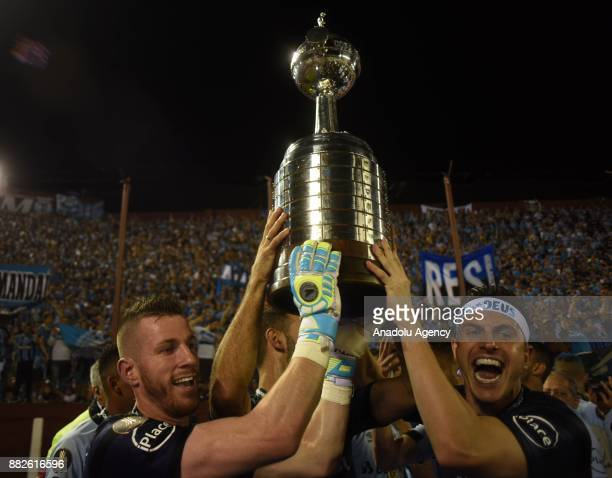 Goalkeepers of Gremio Paulo Victor Vidotti and Marcelo Grohe raise the trophy winning 2 to 1 in Copa Libertadores final match against Lanus at the...
