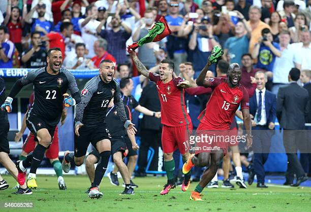 Goalkeepers of Portugal Eduardo and Anthony Lopes Danilo Pereira of Portugal celebrate the victory following the UEFA Euro 2016 final match between...