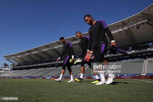 Goalkeepers Paulo Gazzaniga Alfie Whiteman Michel Vorm of Tottenham Hotspur take the field for the Tottenham Hotspur PreSeason Training Session at...