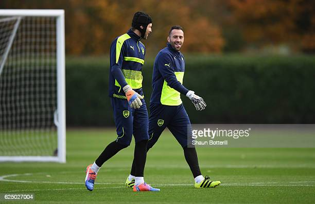 Goalkeepers Petr Cech and David Ospina in discussion during an Arsenal training session on the eve of their UEFA Champions League match against Paris...
