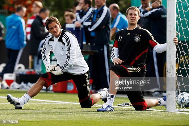 Goalkeepers Rene Adler and Manuel Neuer warm up during a training session of the German national football team at the Bruchweg stadium training...