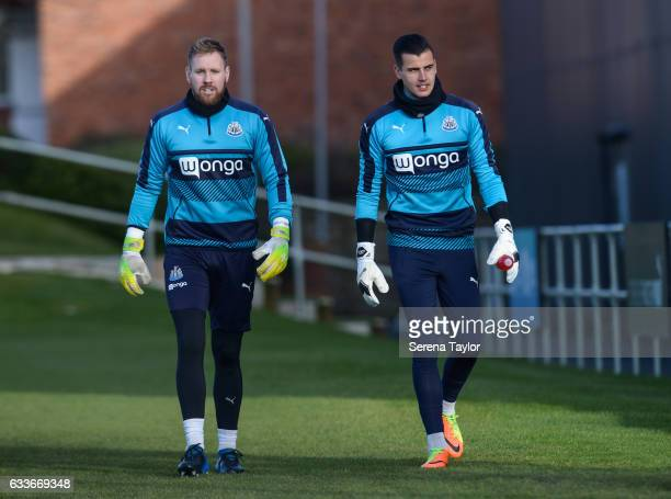 Goalkeepers Rob Elliot and Karl Darlow walk outside during the Newcastle United Training Session at The Newcastle United Training Centre on February...