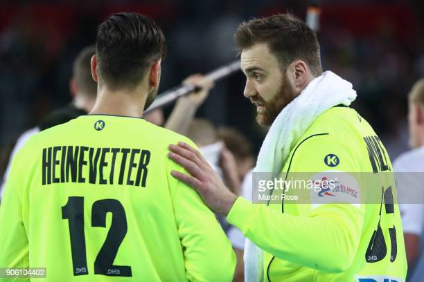 Goalkeepers Silvio Heinevetter of Germany and Andreas Wolff of Germany talk during the Men's Handball European Championship Group C match between...