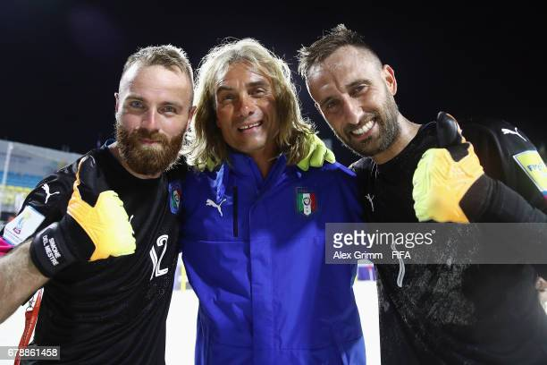 Goalkeepers Simone del Mestre and Stefano Spada of Italy pose with the goalkeeper coach after the FIFA Beach Soccer World Cup Bahamas 2017 quarter...
