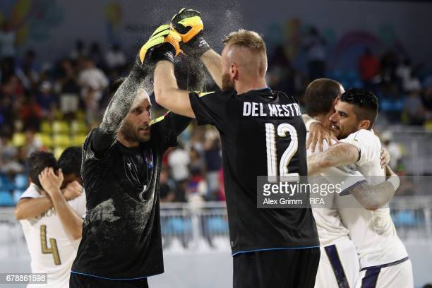 Goalkeepers Stefano Spada and Simone del Mestre of Italy celebrate after the FIFA Beach Soccer World Cup Bahamas 2017 quarter final match between...