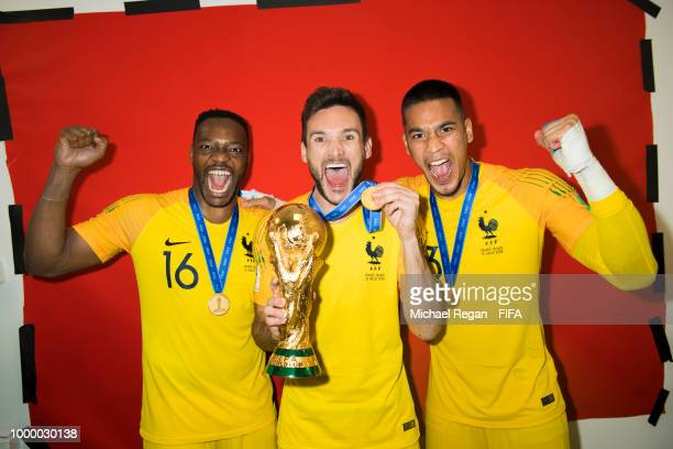 Goalkeepers Steve Mandanda Hugo Lloris and Alphonse Areola of France pose with the Champions World Cup trophy after the 2018 FIFA World Cup Russia...