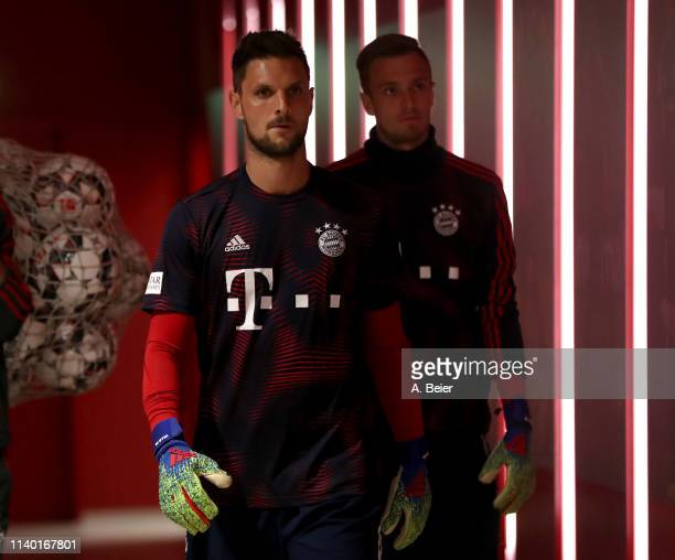Goalkeepers Sven Ulreich and Christian Fruechtl of FC Bayern Muenchen walk in the players' tunnel ahead of the DFB Cup quarter final match between FC...