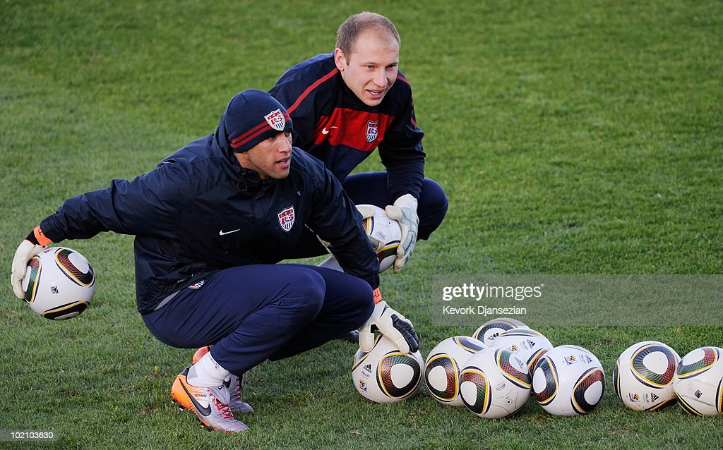 Goalkeepers Tim Howard (L) and Brad Guzan of US national football team look on during a training session on June 15, 2010 in Pretoria, South Africa. Howard has been cleared to play when US will play their next World Cup Group C match against Slovenia on Friday June 18, 2010.