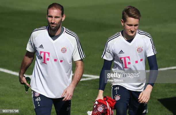 Goalkeepers Tom Starke and Ron Thorben Hoffmann leave after a training session on day 2 of the FC Bayern Muenchen training camp at ASPIRE Academy for...