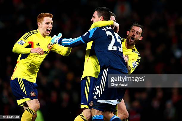 GoalkeeperVito Mannone of Sunderland is congratulated by teammates after saving the penalty from Rafael Da Silva of Manchester United to win the...