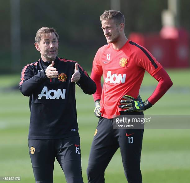 Goalkeeping Coach Frans Hoek and Anders Lindegaard of Manchester United in action during a first team training session at Aon Training Complex on...
